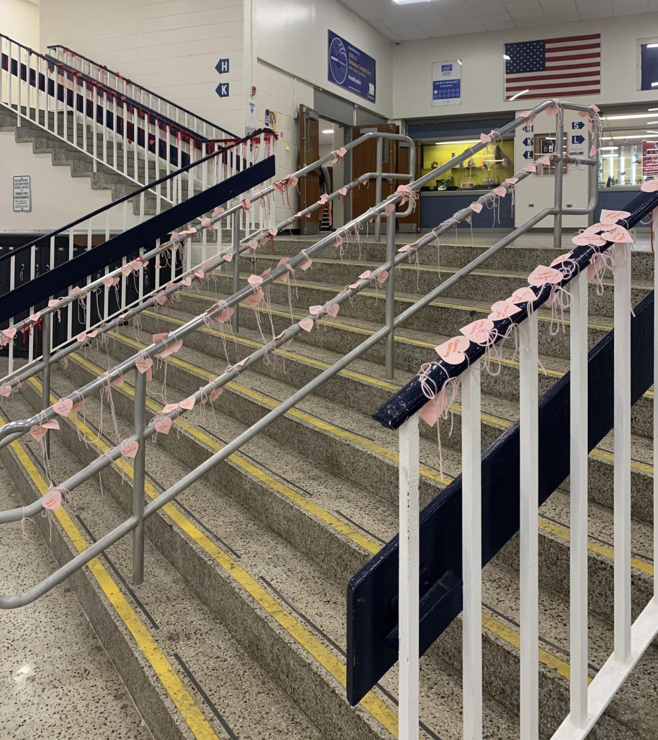 The main stairwell of the commons, adorned with paper hearts