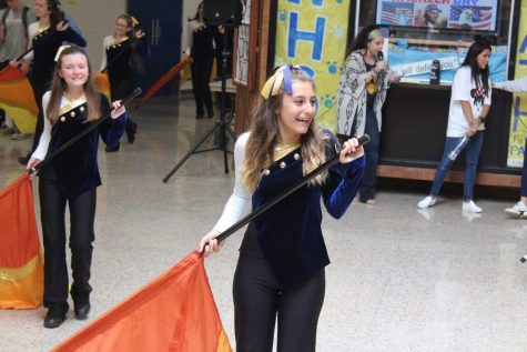 Senior Bella DeStio performs with the Northport Flagline during the 2019 Homecoming Commons Show
