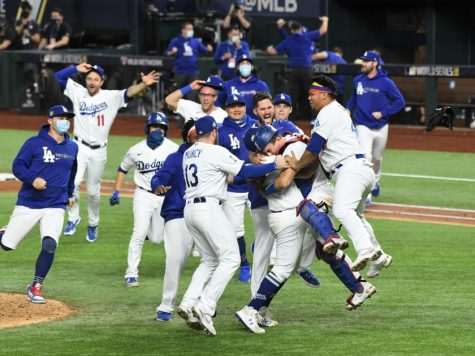 Players on the Los Angeles Dodgers embrace each other after winning Game 6 the 2020 World Series and securing the championship title.