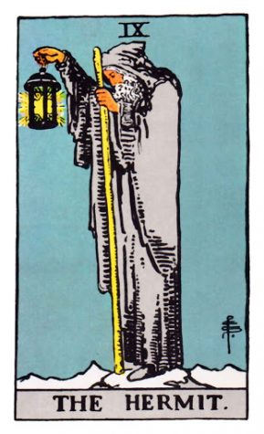 """The Hermit"" tarot card depicts an elderly man atop a snowy mountain."